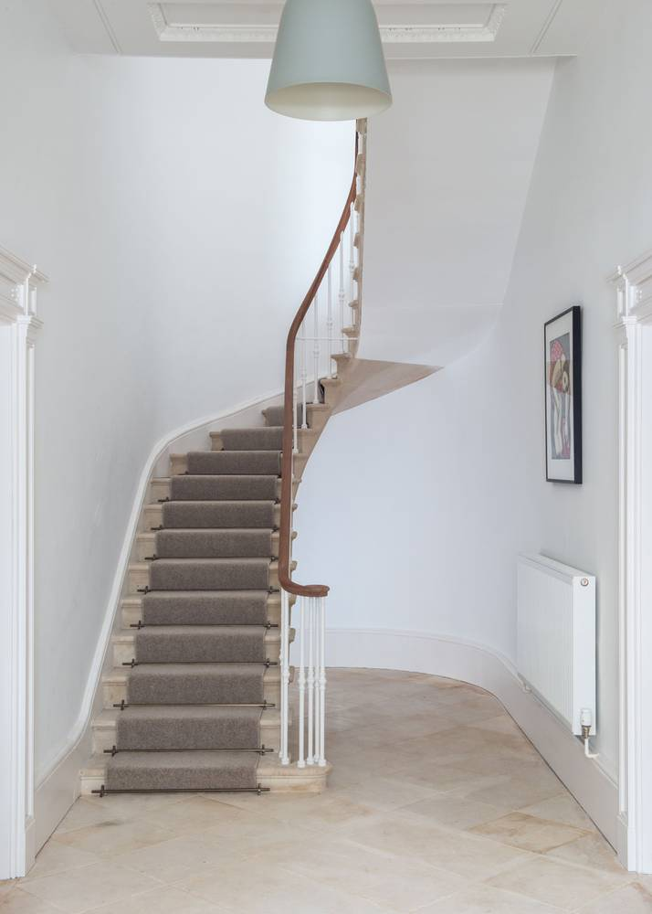 <p>The lower part of this sweeping cantilevered stone stair had been crudely broken out when the building was subdivided into flats. The bottom 14 steps were painstakingly reinserted from the top down in order to tie into the existing stair. </p>